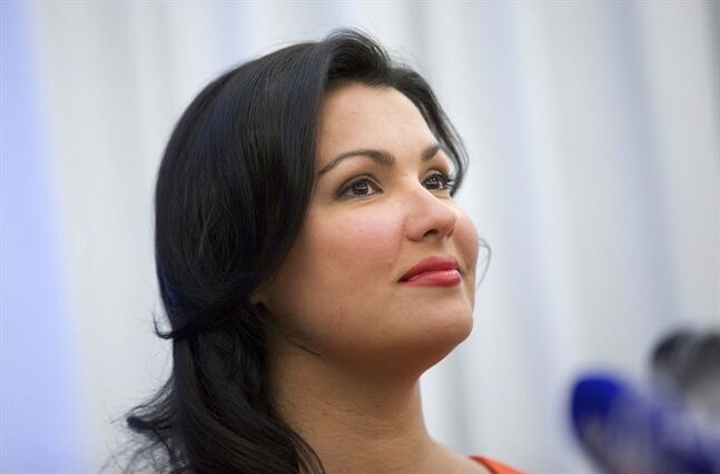"In this picture taken June 18, 2013, Russian leading operatic soprano Anna Netrebko speaks at a news conference in Moscow, Russia. Netrebko has pulled out of plans to play Marguerite in Charles Gounod's ""Faust,"" saying she's decided that the role isn't right for her. The soprano was due to play the part at London's Royal Opera House, in Vienna and in Baden-Baden, Germany later this year. However, she said in a statement Friday, Feb. 28, 2014, ""after much consideration and intensive preparation, I have come to the conclusion that the role is not right for me."" (AP Photo/Ivan Sekretarev)"