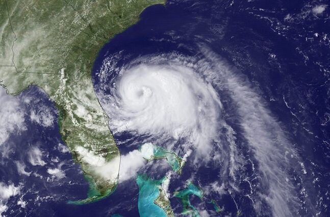 This Wednesday, July 2, 2014, satellite image taken at 3:35 p.m. EDT and released by the National Oceanic and Atmospheric Administration (NOAA), shows Tropical Storm Arthur moving north off the east coast of Florida. The first named storm of the Atlantic hurricane season prompted a hurricane warning for a wide swath of the North Carolina coast and spurred authorities to order a mandatory evacuation for visitors to the Outer Banks' Hatteras Island as of 5 a.m. Thursday, July 3, 2014. Residents also were advised to leave the island. A voluntary evacuation was announced for the Outer Banks' Ocracoke Island, accessible only by ferry. (AP Photo/NOAA)