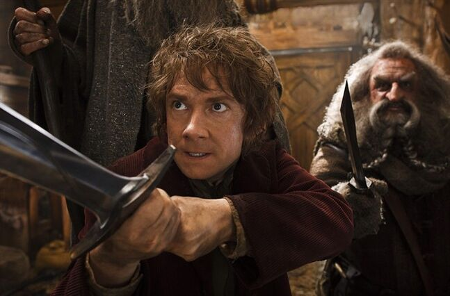 This image released by Warner Bros. Pictures shows Martin Freeman, left, and John Callen in a scene from