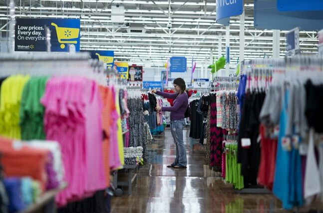 In this June 5, 2014 photo, Chelsea Vick shops for clothes at Wal-Mart Supercenter in Rogers, Ark. The Commerce Department releases retail sales data for May on Thursday, June 12, 2014. (AP Photo/Sarah Bentham)