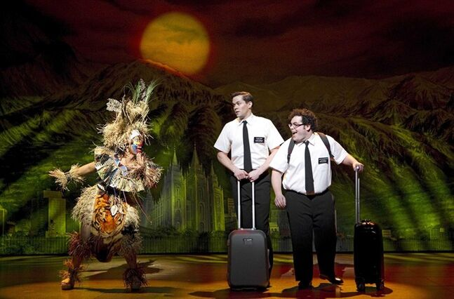 FILE - In this undated file image released by Boneau/Bryan-Brown, from left, Rema Webb, Andrew Rannells and Josh Gad perform in