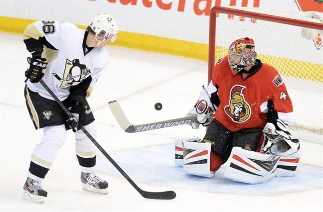 Ottawa Senators' Craig Anderson stops a shot from Pittsburgh Penguins' Jussi Jokinen on his way to a 5-0 shutout during third period NHL hockey action in Ottawa on Monday, Dec. 23, 2013. THE CANADIAN PRESS/Sean Kilpatrick