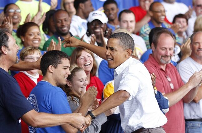 FILE - In this Sept. 6, 2010 file photo, President Barack Obama greets supporters before speaking on the economy at the Milwaukee Laborfest in Henry Maier Festival Park in Milwaukee. The last time President Barack Obama came to Wisconsin to celebrate workers' rights on Labor Day, there was barely a hint of the turmoil that was to come just months later as public employees fought unsuccessfully to retain their ability to collectively bargain. Now, four years later, as the architect of the law that stripped unions of that power faces re-election, Obama is coming back to Milwaukee for an event also featuring Gov. Scott Walker's Democratic challenger Mary Burke. (AP Photo/Pablo Martinez Monsivais)