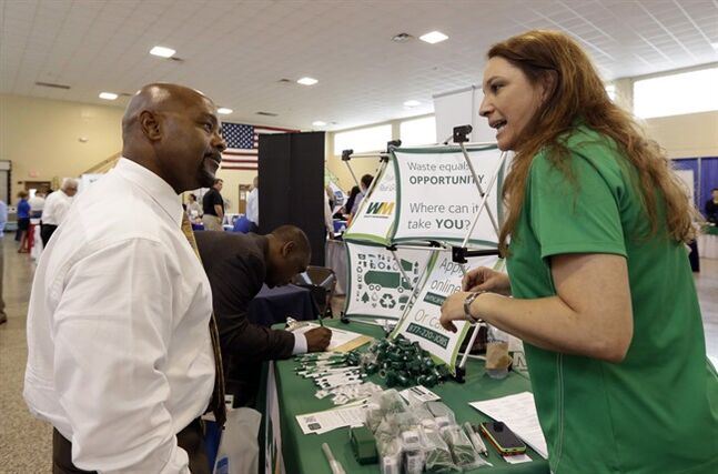 Job seeker and veteran Jimmie Walker, left, listens to job recruiter Desiree Akel, at a Hiring Fair in Fort Lauderdale, Fla. July 16, 2014. THE CANADIAN PRESS/AP, Alan Diaz