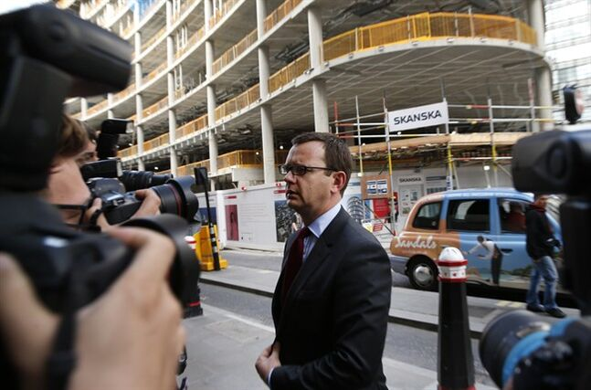 Andy Coulson, former News of the World editor, arrives at the Central Criminal Court in London, Wednesday, June 25, 2014. Coulson was convicted of phone hacking Tuesday, but fellow editor Rebekah Brooks was acquitted after a monthslong trial centering on illegal activity at the heart of Rupert Murdoch's newspaper empire. A jury at London's Old Bailey unanimously found Coulson, the former spin doctor of British Prime Minister David Cameron, guilty of conspiring to intercept communications. The nearly eight-month trial was triggered by revelations that for years the News of the World used illegal eavesdropping to get stories, listening in on the voicemails of celebrities, politicians and even crime victims. (AP Photo/Lefteris Pitarakis)