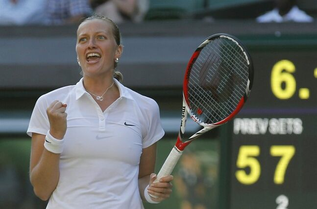 Petra Kvitova of the Czech Republic celebrates winning against Venus Williams of U.S. in their women's singles match at the All England Lawn Tennis Championships in Wimbledon, London, Friday, June 27, 2014. (AP Photo/Sang Tan)
