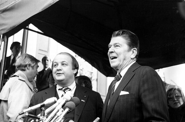 FILE - This Jan. 6, 1981 file photo shows President-elect Ronald Reagan introducing James Brady as his press secretary in Washington. Brady, the affable, witty press secretary who survived a devastating head wound in the 1981 assassination attempt on President Ronald Reagan and undertook a personal crusade for gun control, died Monday. He was 73. (AP Photo/Walt Zebowski, File) (AP Photo/Walt Zebowski, File)