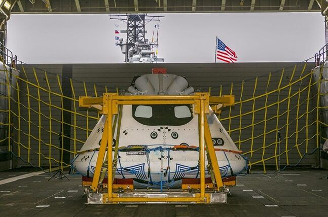 NASA's Orion spacecraft test vehicle sits in the well deck of the USS Anchorage at the Port of Los Angeles on Wednesday, Aug. 6, 2014. NASA, Lockheed Martin and the U.S. Navy will conduct recovery tests for the capsule in the Pacific Ocean, simulating its return from a space mission. (AP Photo/Damian Dovarganes)