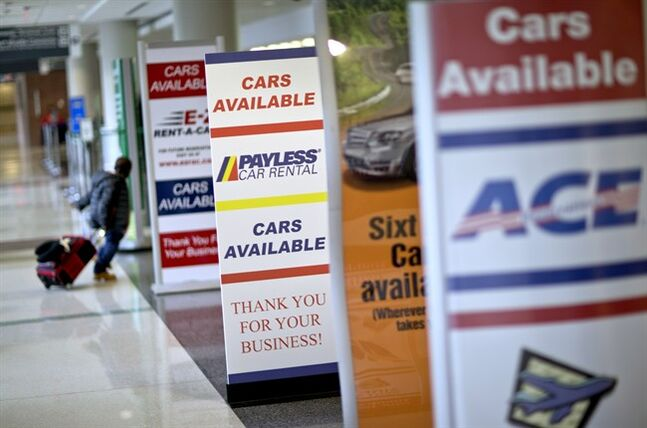Banners advertising rental cars stand along the check-in counters at Hartsfield-Jackson Airport, Nov. 27, 2013, in Atlanta. THE CANADIAN PRESS/AP, David Goldman