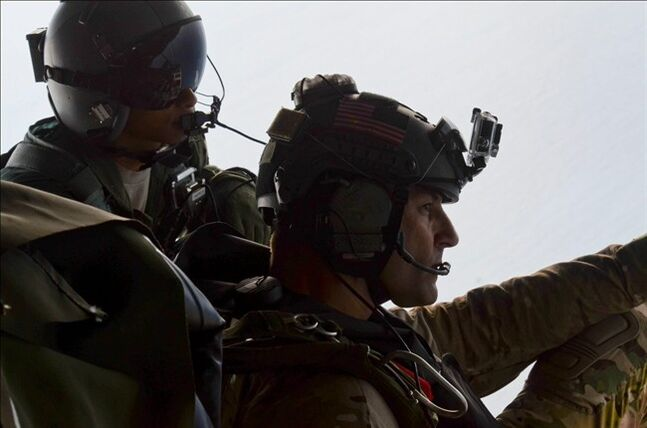 In this May 3, 2014, image provided by the U.S. Air Force, Airman 1st Class Franscisco Harper, left, and a pararescue Airman survey the area as U.S. Air Force pararescue forces parachute into the Pacific Ocean to aid to two critically injured sailors aboard a Venezuelan fishing boat. The Venezuelan fishing boat found the sailors floating in a raft Friday afternoon after their vessel sank off the coast of Mexico, said Sarah Schwennese, spokeswoman at the Davis-Monthan Air Force Base in Tucson. (AP Photo/U.S. Air Force, Staff Sgt. Adam Grant)