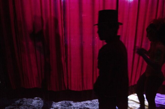 In this June 25, 2014 photo Alma Orocco, the ringmaster, waits backstage at the Fuentes Gasca Brothers Circus in Mexico City, Wednesday, June 25, 2014. Orocco and hundreds of other circus performers have taken to the streets of Mexico City recently to protest legislation that will ban the use of animals in the circus. The circuses have one year to change their acts or face steep fines. (AP Photo/Sean Havey)