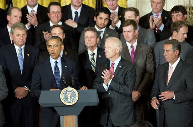 President Barack Obama, front left to right, with Vice President Joe Biden and House Speaker John Boehner, R-Ohio, speaks honoring members of the 2013 Presidents Cup team during a ceremony in the East Room of the White House, Tuesday, June 24, 2014 in Washington. The U.S. team beat an international squad during the Presidents Cup matches in October 2013. (AP Photo/Manuel Balce Ceneta)