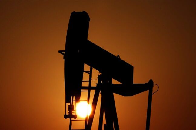 An oil pump works at sunset in the desert oil fields of Sakhir, Bahrain, on Jan. 22, 2013. THE CANADIAN PRESS/AP, Hasan Jamali