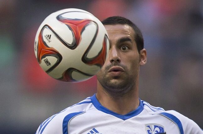 Montreal Impact's Andres Romero follows the ball during first half MLS soccer action against the Vancouver Whitecaps in Vancouver, B.C., on Wednesday June 25, 2014. It was surprising to see Romero back with the Montreal Impact after a weak 2013 campaign that ended in a three-game suspension for a fight in a playoff game. THE CANADIAN PRESS/Darryl Dyck