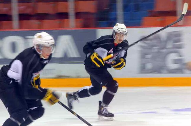 Wheat Kings forward Alessio Bertaggia, right, streaks up the ice during practice Friday at Westman Place.