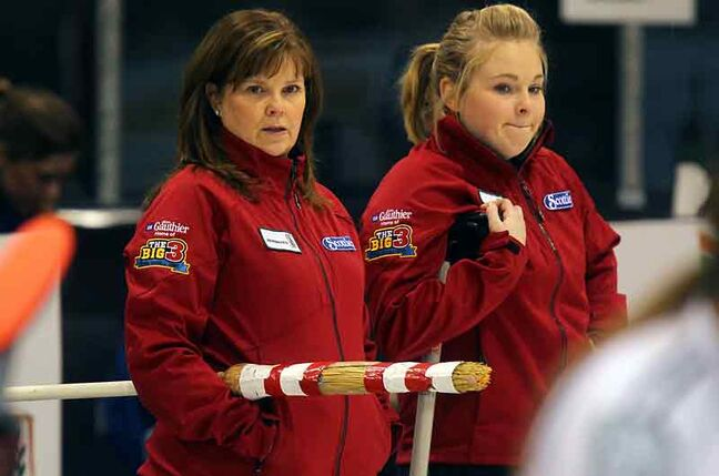 Barb Spencer, left, and her daughter Katie survey the action during their 9–1 victory over Thompson's Charlene Norquay on Thursday at the Scotties Tournament of Hearts in Stonewall. The Spencer team, from Winnipeg, is off to a 4–0 start.