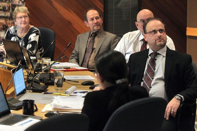 BSD secretary-treasurer Denis Labossiere, (front), and trustees Mark Sefton, Peter Bartlett and Pat Bowslaugh listen to presentations on Monday evening.  (Colin Corneau/Brandon Sun)