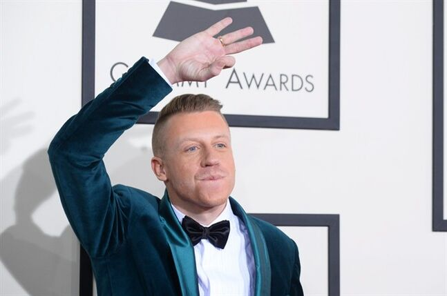 Macklemore arrives at the 56th annual GRAMMY Awards at Staples Center on Sunday, Jan. 26, 2014, in Los Angeles. (Photo by Jordan Strauss/Invision/AP)