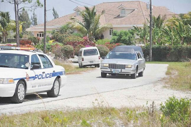 A hearse takes the body of Edgar Dart to the morgue on Grand Bahama. No arrests have been made after the violent robbery that claimed Dart's life.