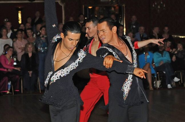 Sergio Brilhante, left, and Jonathan Morrison take part in a ballroom dancing competition . The governing body of ballroom dancing in Britain has stirred controversy by proposing to ban same-sex couples from competitions. The British Dance Council says it is voting to change the definition of a competing partnership to be