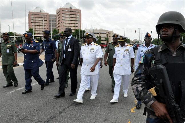 Nigeria's chief of defense staff Air Marshal Alex S. Badeh, second from left, and other army chiefs arrive to address the Nigerians Against Terrorism group during a demonstration calling on the government to rescue the kidnapped girls of the government secondary school in Chibok, in Abuja, Nigeria, Monday, May 26, 2014. Scores of protesters chanting