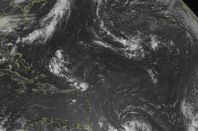 This NOAA satellite image taken Thursday, July 31, 2014 at 10:45 AM EDT shows widely scattered clouds across the Caribbean Basin. A cluster of clouds is present north of Hispaniola, Puerto Rico, and the Virgin Islands. A tropical wave is struggling to organize well east of the Lesser Antilles as it tracks westward. (AP Photo/Weather Underground)