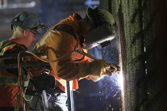 FILE - In this May 1, 2014 file photo, welders connect iron support bars during construction inside the cavern of the Second Avenue subway tunnel at 86th Street, in New York. The Commerce Department releases construction spending for April, on Monday, June 2, 2014. (AP Photo/Bebeto Matthews, File)
