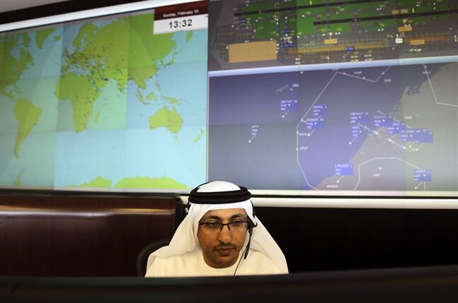 In this Sunday, Feb. 10, 2013, photo. an Emirati technician works at the Emirates Network Control Center in Dubai, United Arab Emirates. For generations, international fliers have stopped over in London, Paris and Amsterdam. Now, they increasingly switch planes in Dubai, Doha and Abu Dhabi, making this region the new crossroads of global travel. The switch is driven by both the airports and airlines, all backed by governments that see aviation as the way to make their countries bigger players in the global economy. (AP Photo/Kamran Jebreili)