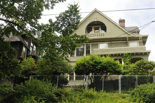 This Tuesday, June 24, 2014 photo shows the house built in 1892 that venture capitalist Kevin Rose has opted to sell to neighbors in northwest Portland instead of demolishing it. He initially planned to renovate the structure, but when that became costly, he decided to tear it down and build a modern home which outraged neighbors who didn't want the historic home demolished. Rose is a general partner for Google Ventures. (AP Photo/The Oregonian, Stephanie Yao Long)