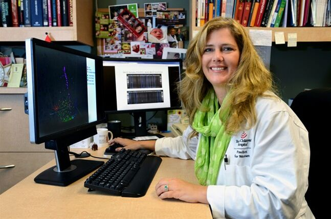 This handout photo provided by the Baylor College of Medicine, taken May 20, 2014, shows Dr. Kjersti Aagaard in her laboratory at the Baylor College of Medicine in Houston. Aagaard's new research shows a small but diverse community of bacteria lives in the placentas of healthy pregnant women, and hints that the microbes may play a role in premature birth. (AP Photo/Agapito Sanchez, Baylor College of Medicine)
