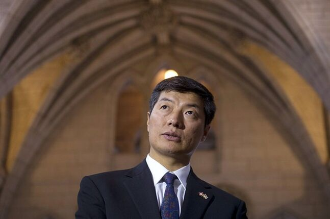 Tibetan exiled politician Lobsang Sangay waits to appear at the Subcommittee on International Human Rights of the Standing Committee on Foreign Affairs and International Development Tuesday February 26, 2013 in Ottawa. THE CANADIAN PRESS/Adrian Wyld
