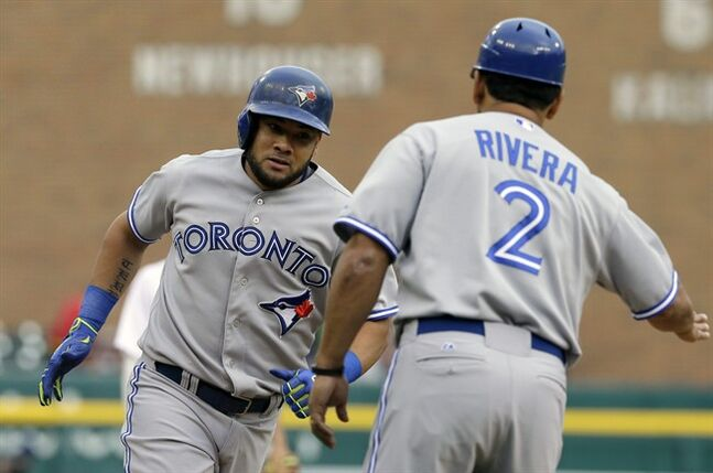 Toronto Blue Jays' Melky Cabrera rounds third base after his solo home run off Detroit Tigers starting pitcher Rick Porcello during the first inning of a baseball game in Detroit, Wednesday, June 4, 2014. (AP Photo/Carlos Osorio)