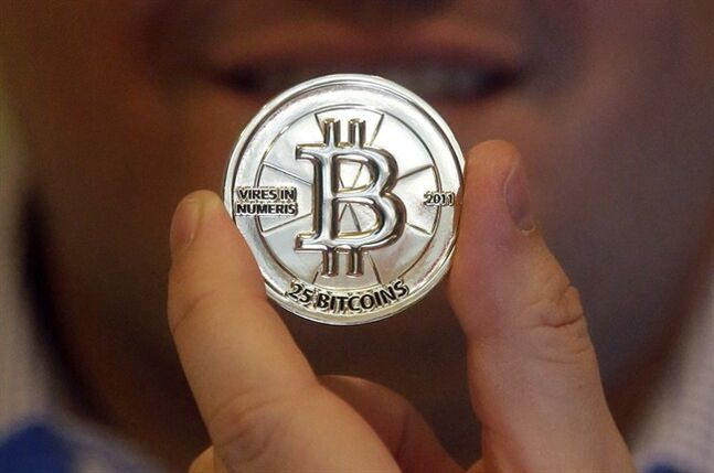 In this April 3, 2013 photo, a 25 Bitcoin token is shown in Sandy, Utah. THE CANADIAN PRESS/AP, Rick Bowmer
