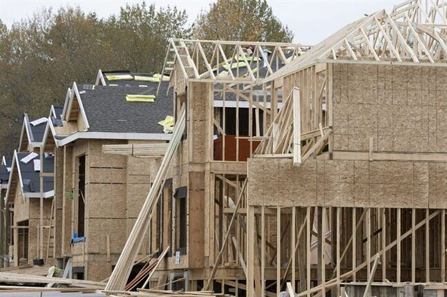 New homes are shown being built in Abbotsford, B.C. Saturday, Oct. 27, 2007. THE CANADIAN PRESS/Jonathan Hayward