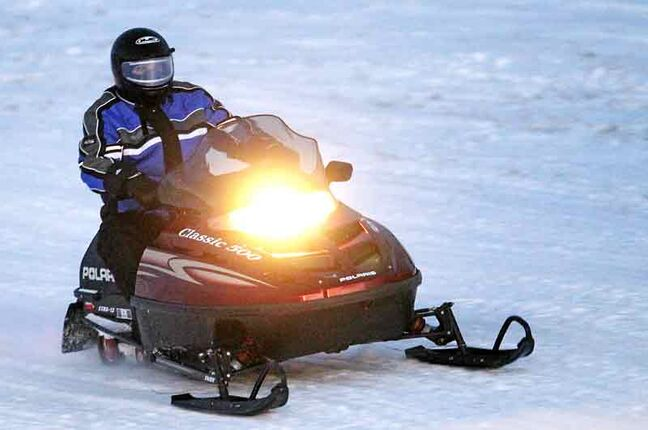 A snowmobiler cruises along the ditch beside Highway 262 north of Minnedosa late Sunday afternoon.
