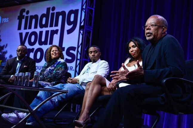 In this Wednesday, July 23, 2014 photo released by PBS, from left, actor Courtney B. Vance, actor and playwright Anna Deavere Smith, recording artist Nas, actor Khandi Alexander and host/executive producer/writer/presenter Henry Louis Gates Jr. discuss uncovering family histories during PBS'