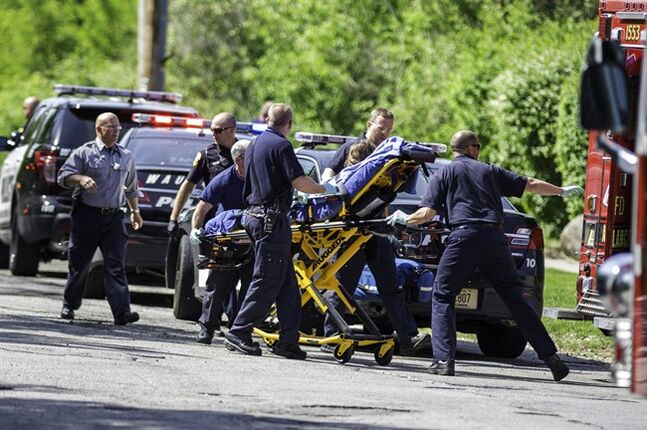 FILE - In this May 31, 2014 file photo rescue workers take a 12-year-old stabbing victim to the ambulance in Waukesha, Wis. One of two 12-year-old Wisconsin girls charged as an adult with stabbing the girl, a classmate, to please a fictional online horror character is mentally incompetent and can't stand trial, a judge said Friday, Aug. 1, 2014. The judge also ordered that she be committed for treatment, and said that attorneys have a year to restore her to competency. (AP Photo/Abe Van Dyke, File)