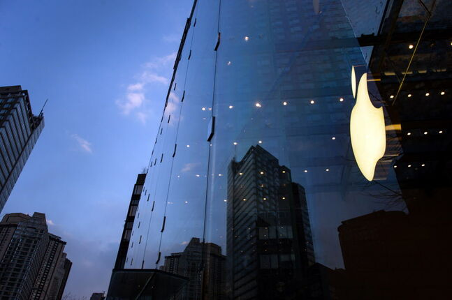 The Apple logo is seen in the window of a store in New York..