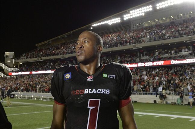 Ottawa Redblacks Henry Burris (1) looks on after the end of CFL action at TD Place in Ottawa on July 18, 2014. Henry Burris is back. The veteran quarterback will face his former Hamilton teammates for the first time Saturday night when the expansion Ottawa Redblacks visit the Tiger-Cats. Burris, 39, spent two seasons in Hamilton, leading the Ticats to the Grey Cup final last year. THE CANADIAN PRESS/Justin Tang