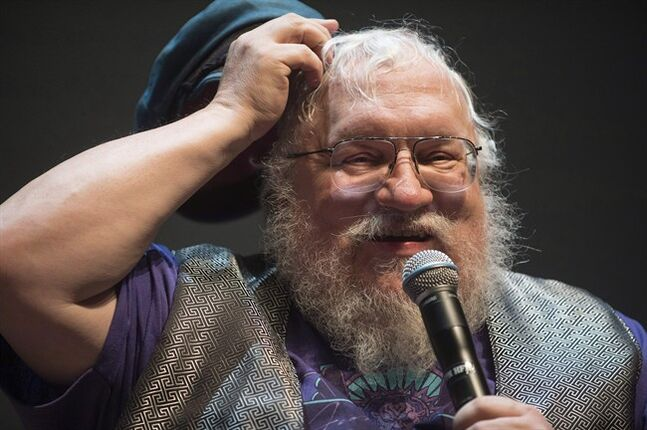 George R. R. Martin, creator of the drama series Game of Thrones, speaks at the 14th edition of the Neuchatel International Fantastic Film Festival, NIFF, in front of fans during a lecture at the Theatre du Passage in Neuchatel, Switzerland, Thursday, July 10, 2014. Martin admits that some fans have correctly guessed how he intends to end the series and he's even considered changing the story's big conclusion. THE CANADIAN PRESS/AP-Keystone, Sandro Campardo