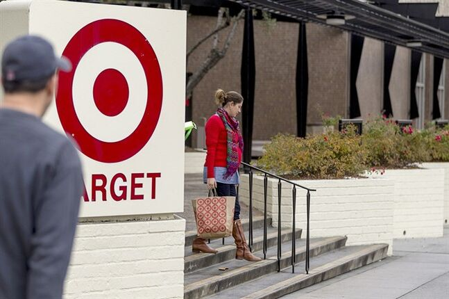 Shoppers walk past a Target store in Pasadena, Calif., on Dec. 19, 2013. THE CANADIAN PRESS/AP, Damian Dovarganes