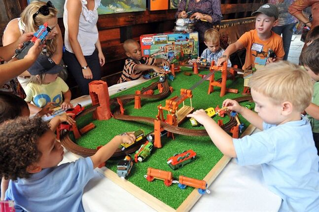 Kids play with Thomas & Friends (TM) toys durnig a photo op on Aug. 26, 2010, in New York.THE CANADIAN PRESS/HO, AP Images