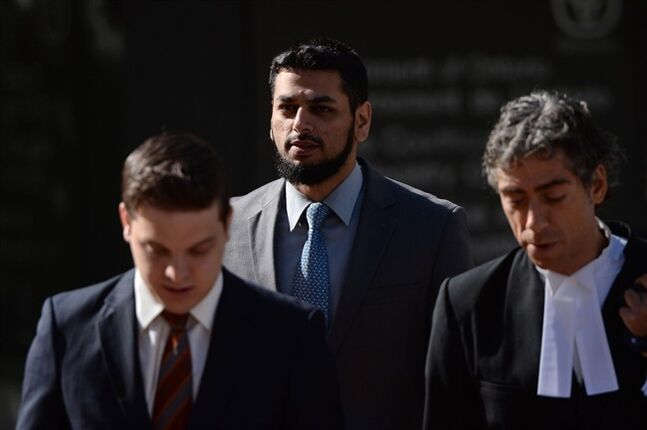 Khurram Syed Sher, centre, walks with his lawyers outside court in Ottawa on Tuesday, Aug. 19, 2014. Sher is charged with conspiring to facilitate terrorism. THE CANADIAN PRESS/Sean Kilpatrick
