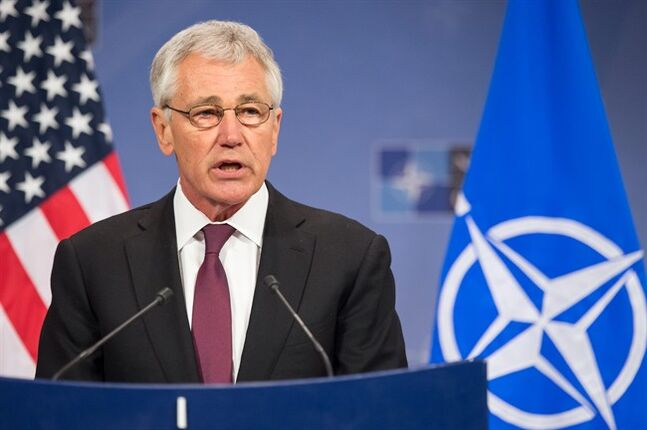 U.S. Secretary of Defense Chuck Hagel addresses the media after a meeting of NATO defense ministers at NATO headquarters in Brussels on Thursday, Feb. 27, 2014. NATO defense ministers, in a second day of meetings, discussed the situation in Ukraine and Afghanistan. (AP Photo/Geert Vanden Wijngaert)