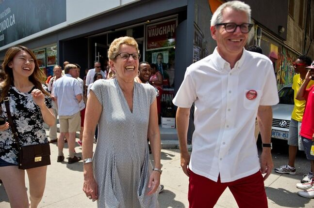 Ontario Premier Kathleen Wynne and Federal Liberal Trinity-Spadina by-election candidate Adam Vaughan depart after a rally at Vaughan's campaign office in Toronto, Saturday, June 28, 2014. THE CANADIAN PRESS/Galit Rodan