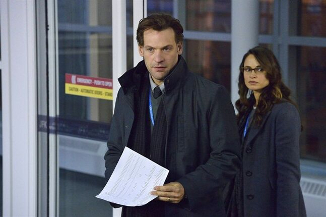 This image released by FX shows Corey Stoll, left, and Mia Maestro in a scene from the new series
