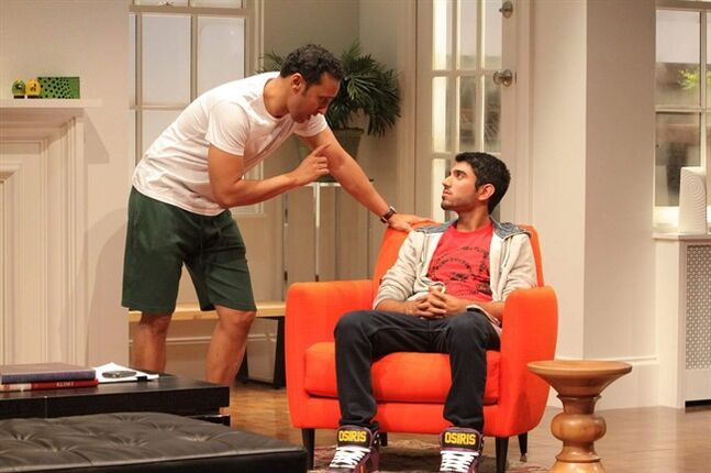 FILE - This undated file theater image released by Philip Rinaldi Publicity shows Aasif Mandvi, left, and Omar Maskati in a scene from Ayad Akhtar's play,