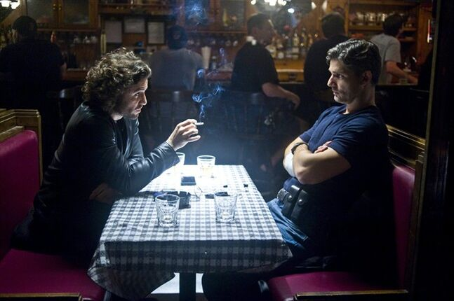 This image released by Sony Pictures shows Edgar Ramirez, left, and Eric Bana in a scene from Screen Gems'