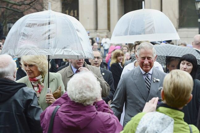 Prince Charles, right, and his wife Camilla are greeted in Charlottetown, P.E.I. on Tuesday, May 20, 2014. THE CANADIAN PRESS/Paul Chiasson