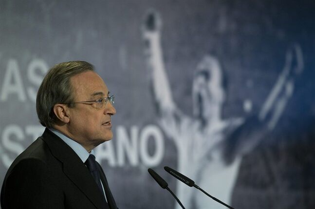 Real Madrid's President Florentino Perez speaks in front of a poster of Alfredo Di Stefano in Madrid, Spain, Monday, July 7, 2014 after football great Alfredo Di Stefano died. He was 88. The former Argentina forward was hospitalized on Saturday after a heart attack. He had been in a coma since at Gregorio Maranon hospital in the Spanish capital where he passed away. Di Stefano helped Madrid win five straight European Champions Cups from 1956-60 and eight Spanish league titles. He was voted European player of the year in 1957 and 1959. (AP Photo/Paul White)